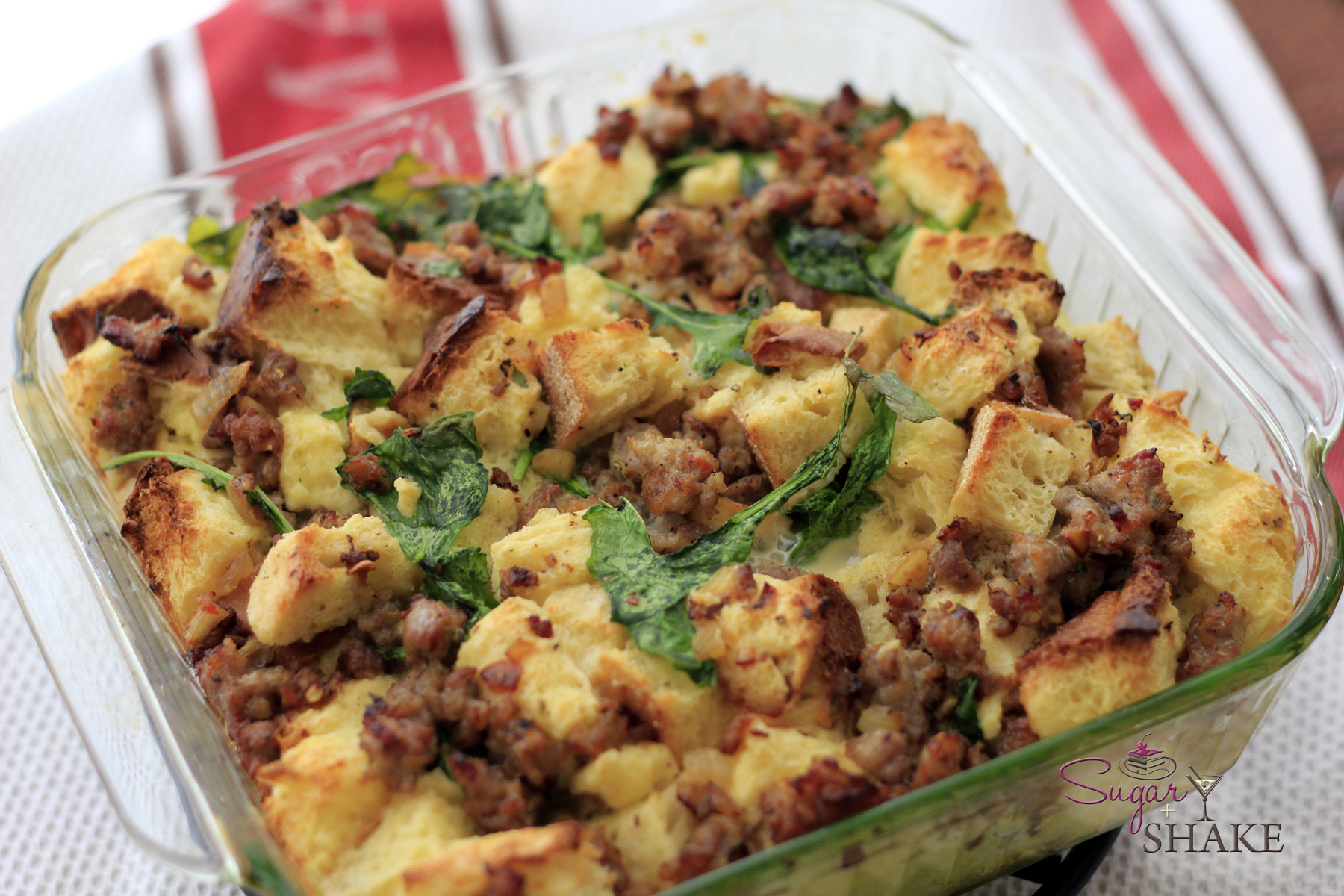 """""""Breakfast Bread Pudding"""" — French Bread and Sweet Bread with Italian Sausage and Arugula. © Sugar + Shake"""
