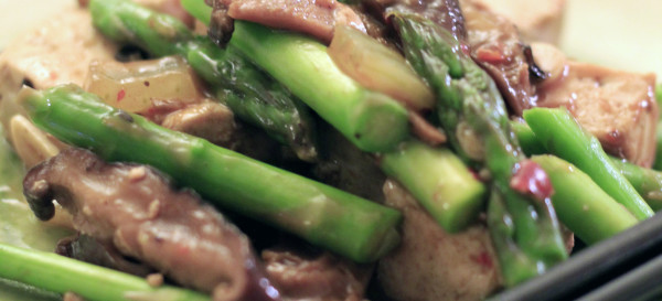 Our meatless adventure: Tofu, asparagus, shiitake mushrooms, onions and a LOT of garlic stir-fried in a black bean and to ban jian sauce. © Sugar + Shake
