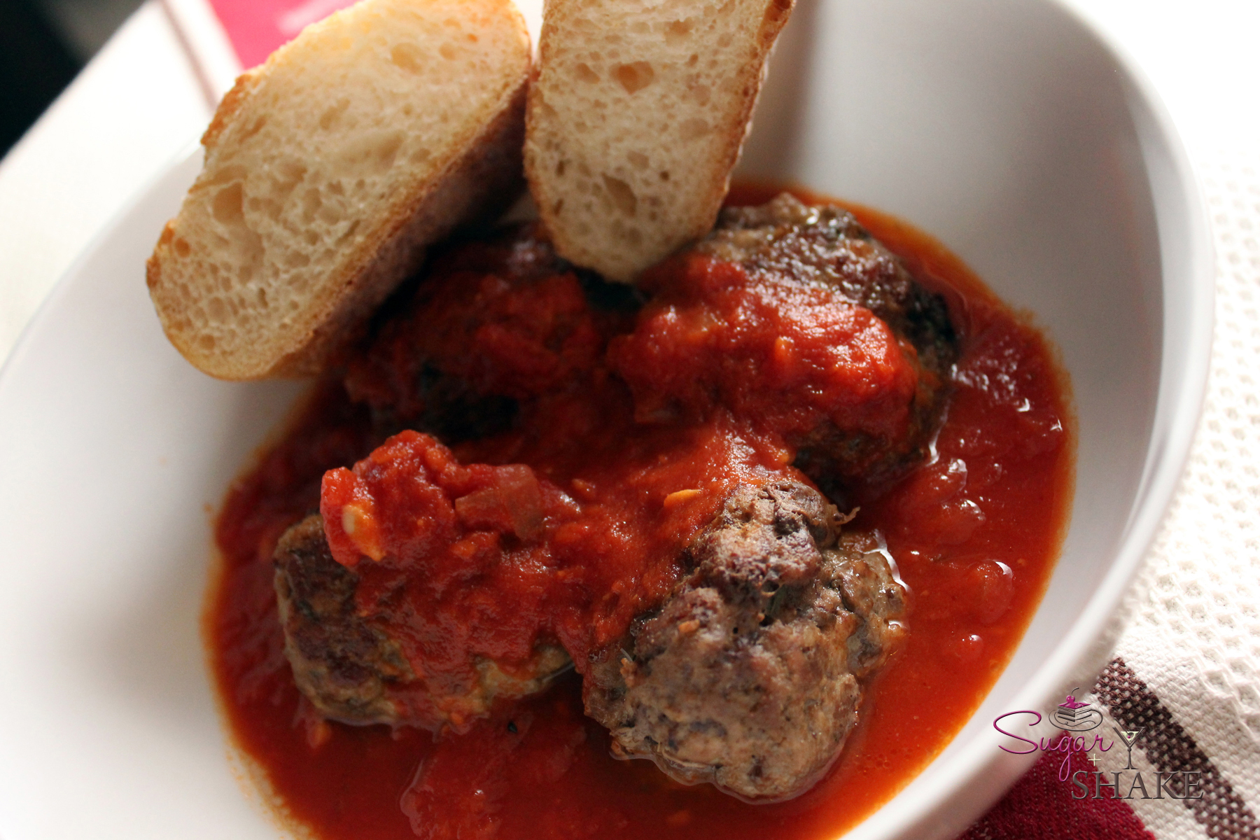 Big Island veal & beef meatballs with homemade marinara sauce. © Sugar + Shake