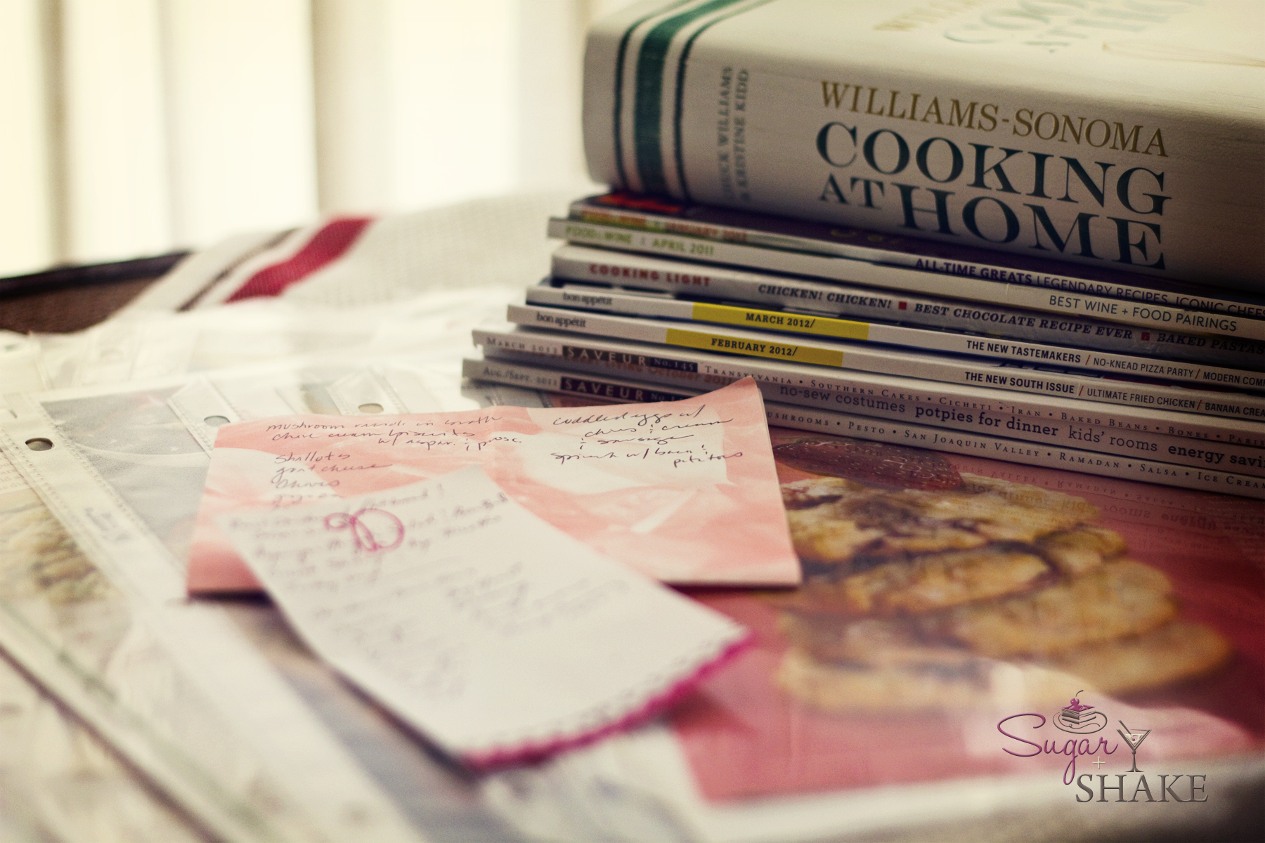Menu planning: piles of clippings, cookbooks and magazines to sort through. © Sugar + Shake