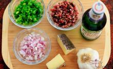 Italian beer bread ingredients (clockwise from upper left): green onions, salami, Peroni Italian beer, garlic, Manchego cheese, shallots. © Sugar + Shake
