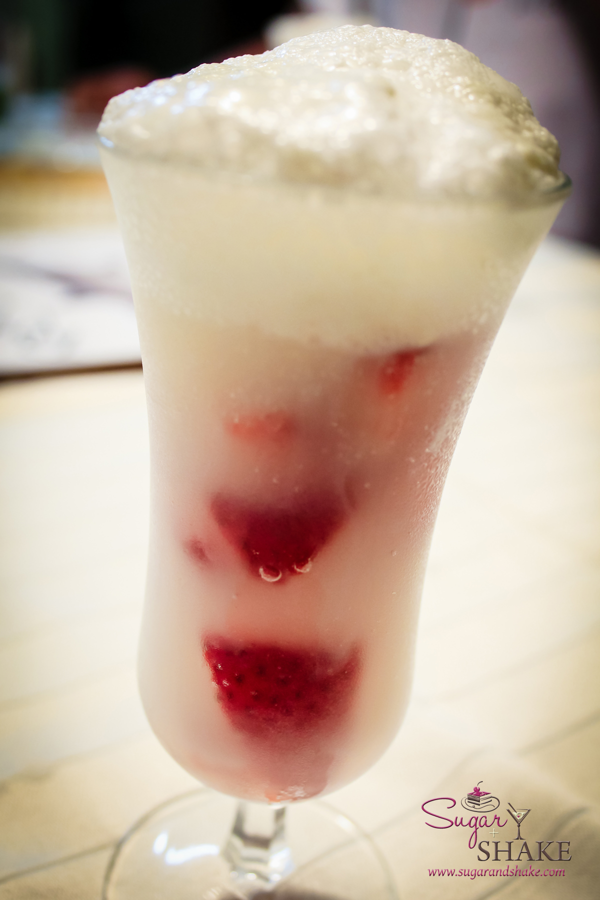 Sugar's Strawberries & Cream Sparkler. Prosecco with macerated strawberries, topped with homemade frozen honey cream. © 2013 Sugar + Shake