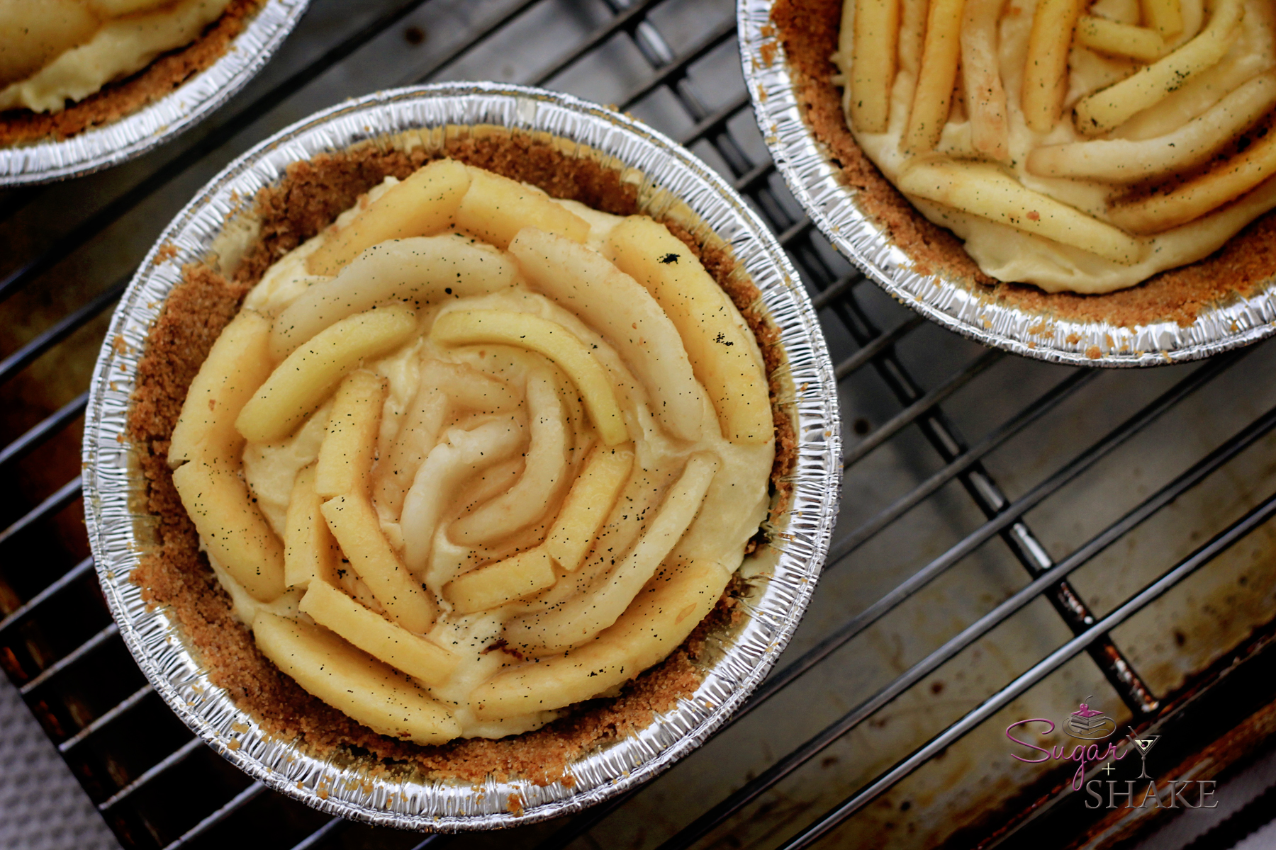 Apple and pear slices set in a rose pattern into an almond custard filling. Graham cracker crust. © 2012 Sugar + Shake