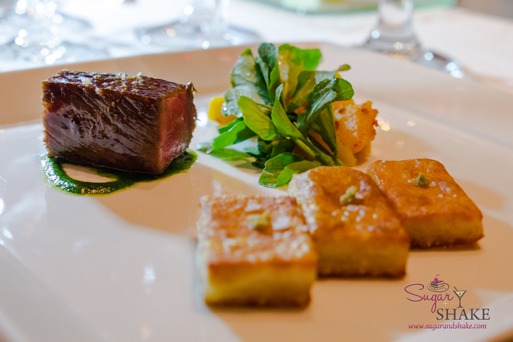 Chef Mavro Fall 2014 Menu Tasting. Wagyu pavé, pomegranate-teriyaki glaze, Sumida Farm watercress, sautéed kabocha, potato kochi with yuzu kosho accent. © 2014 Sugar + Shake