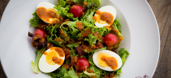 "Sunday Salad: Mixed greens with tomatoes, bacon, hard-boiled eggs and ""French-ish"" dressing. © 2015 Sugar + Shake"